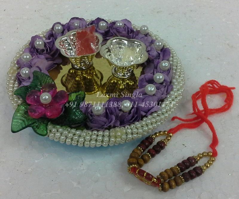 Pooja thali for rakhi pooja aarti thali decoration for Aarti thali decoration designs