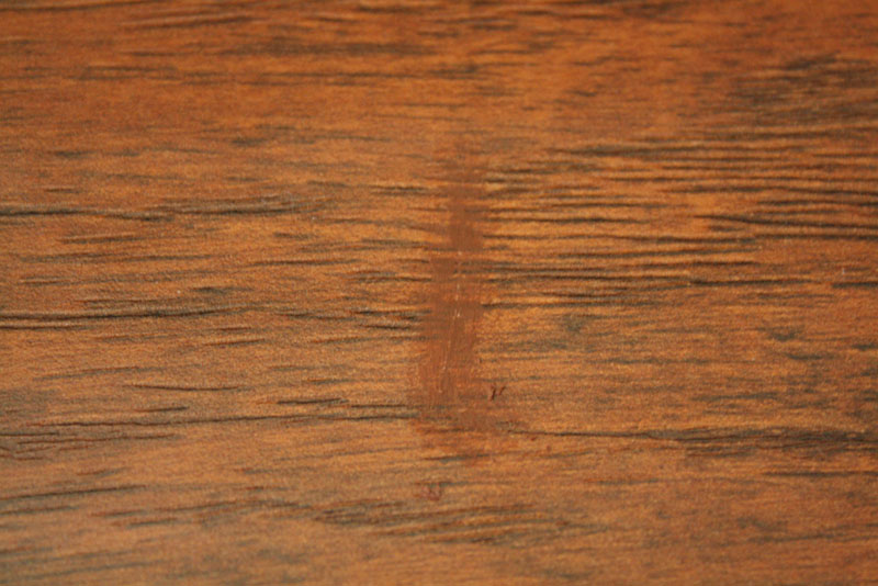 how to fix swollen laminate flooring
