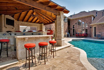 fresh transitional outdoor with various seating options and clean groovy pool
