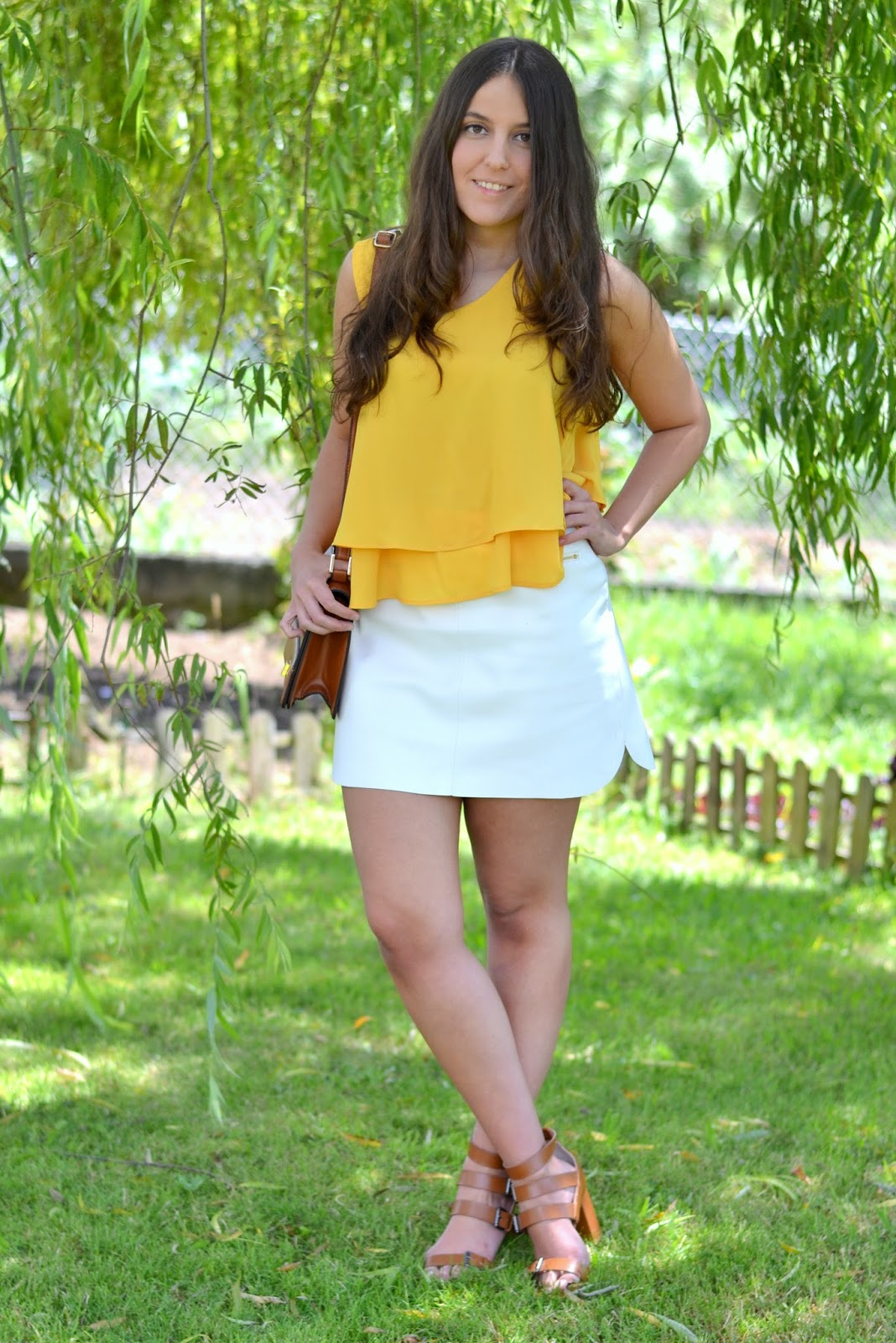 mustard top, leatherette skirt, camel sandals and bag