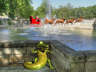 Le Père Noël survole les jardins de la fontaine à Nîmes