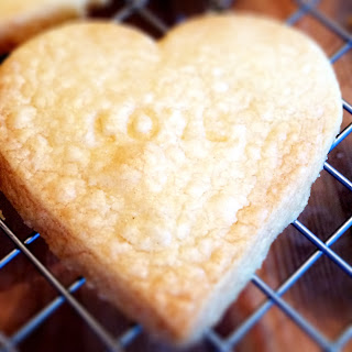Shortbread biscuit cooling on tray with love stamp
