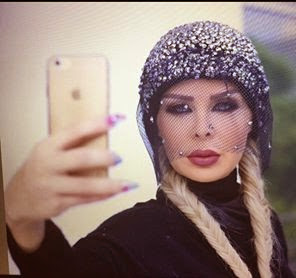 رولا سعد بفستان نمرى جلد
