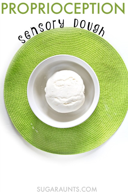 Make this marshmallow fondant dough recipe for a sensory play experience with kids.  The proprioceptive and strengthening input is unbelievable with this resistive and tough dough.  Sensory spectrum kids can get a calming and full body proprioception activity with this dough, from upper extremity to lower extremity for calming and relaxing heavy work.