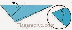 Bước 9: Gấp ngược cạnh giấy bên trên ra ngoài.