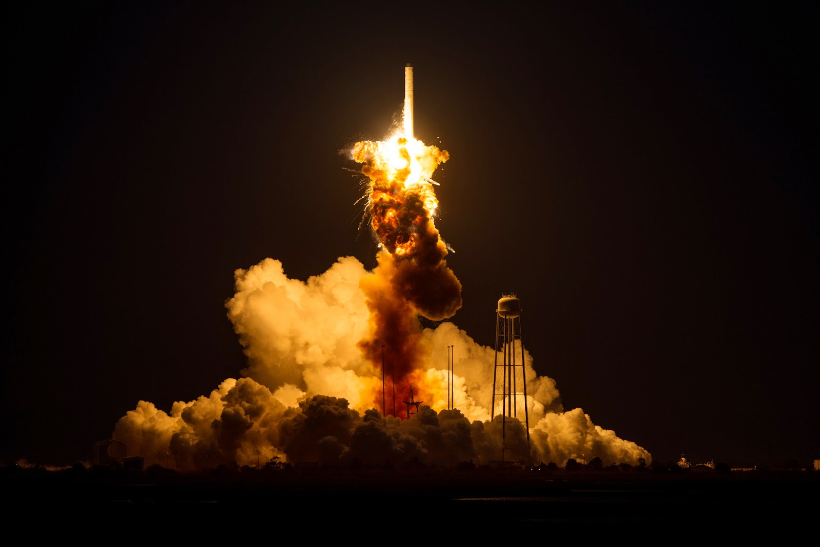 The Orbital Sciences Corporation Antares rocket, with the Cygnus spacecraft onboard suffers a catastrophic anomaly moments after launch from the Mid-Atlantic Regional Spaceport Pad 0A, Tuesday, Oct. 28, 2014, at NASA's Wallops Flight Facility in Virginia. The Cygnus spacecraft was filled with about 5,000 pounds of supplies slated for the International Space Station, including science experiments, experiment hardware, spare parts, and crew provisions. Credit: NASA/Joel Kowsky