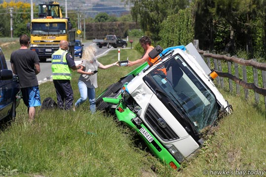 An Environmental Bins Ltd truck in a stormwater ditch on St Georges Rd North, Waipatu, Hastings, after hitting the back end of a ute. Police attended. photograph