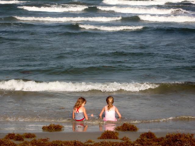 Little Girlfriends sitting on the beach