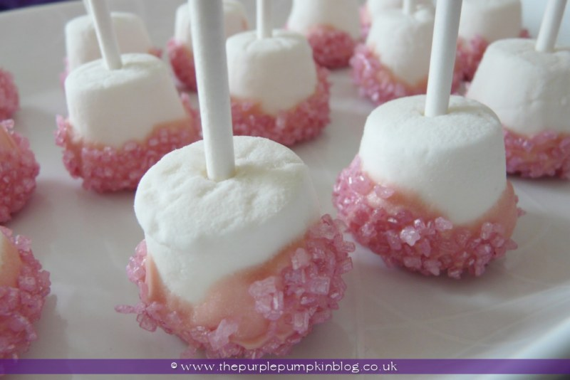 pink encrusted marshmallow pops for a baby shower at the purple
