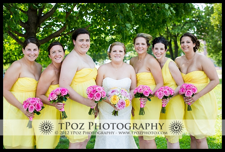 bridesmaids in yellow dresses pink flowers