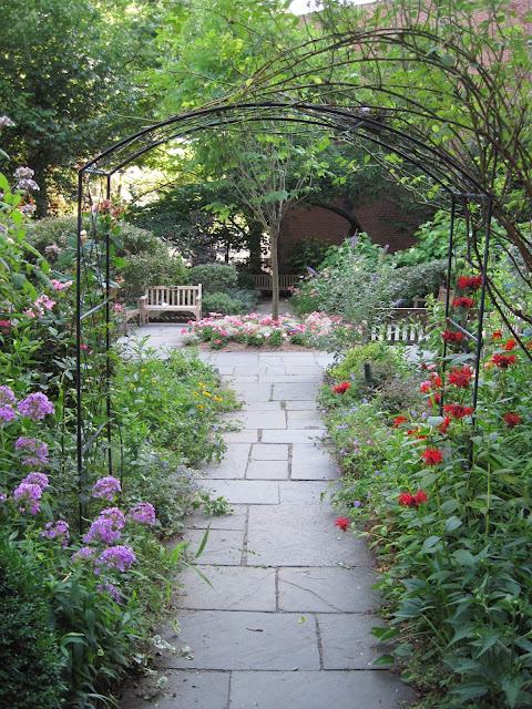 Take another look at this beautiful Old New York arch which welcomes visitors to the Gardens of Saint Luke in the Fields