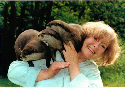 Daphne Neville with her tame otters