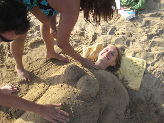Natasha, Ani and I burying poor Jana in the sand.