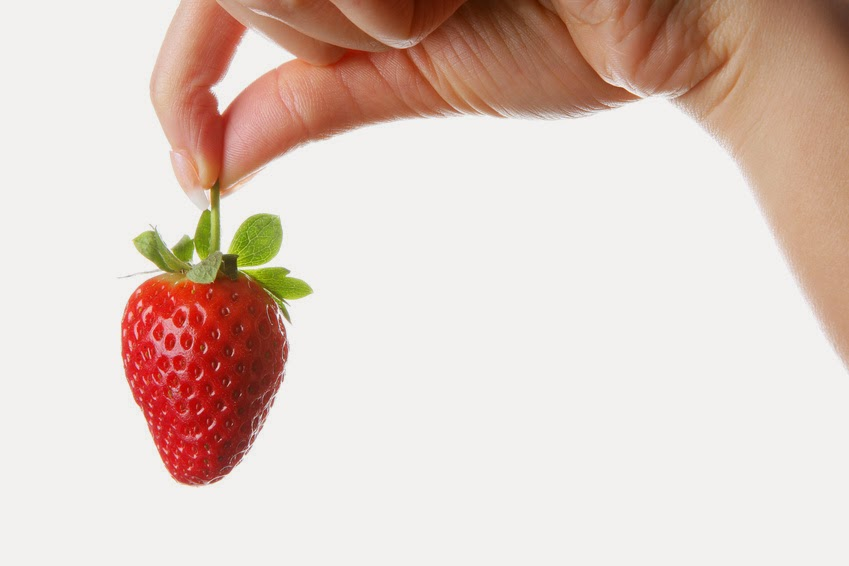 Woman Holding a Strawberry.