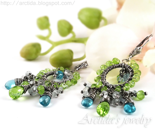 http://www.arctida.com/en/gallery-sold/103-apatite-peridot-earrings-sterling-silver-ituralde.html