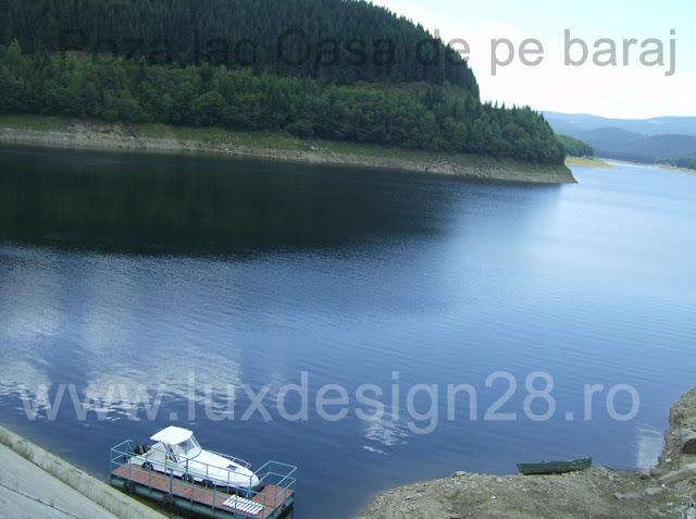 Fotografie realizata de pe barajul Oasa asupra lacului de acumulare Oasa - pe lac este interzis ambarcatiunilor