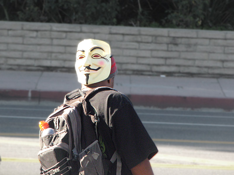 Occupy Los Angeles - someone wearing an Anonymous/Guy Fawkes mask on the back of his head