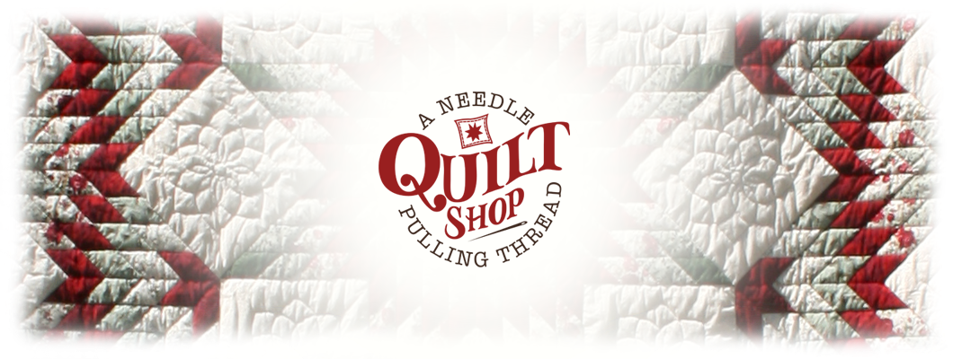 A Needle Pulling Thread Quilt Shop