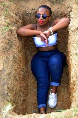 Naija babe pose inside a grave