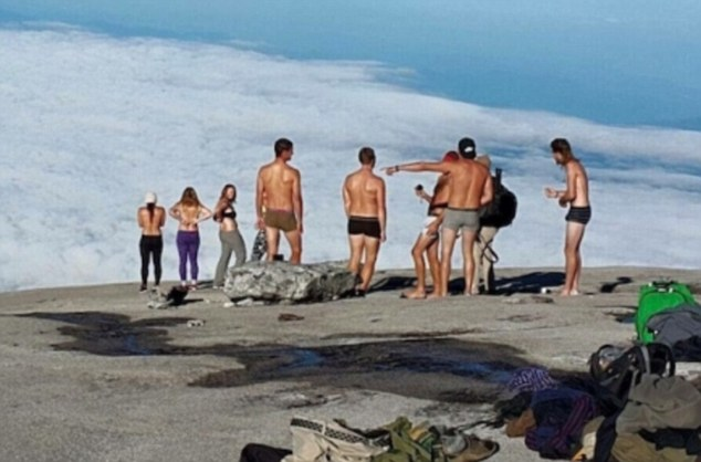 The guilty party of 10 were climbing Kinabalu on May 30th when they broke away from their party to strip off and take some photos.