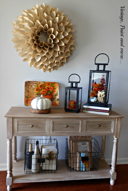 Vintage, Paint and more... Fall in the entry with thrifted lanterns, book page wreath, painted and twine wrapped bottles and DIY book jackets