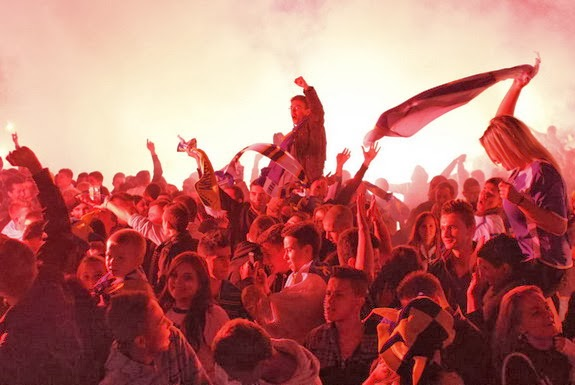 Bosnian fans celebrate their team's success in Sarajevo, while some of them were lost in Latvia