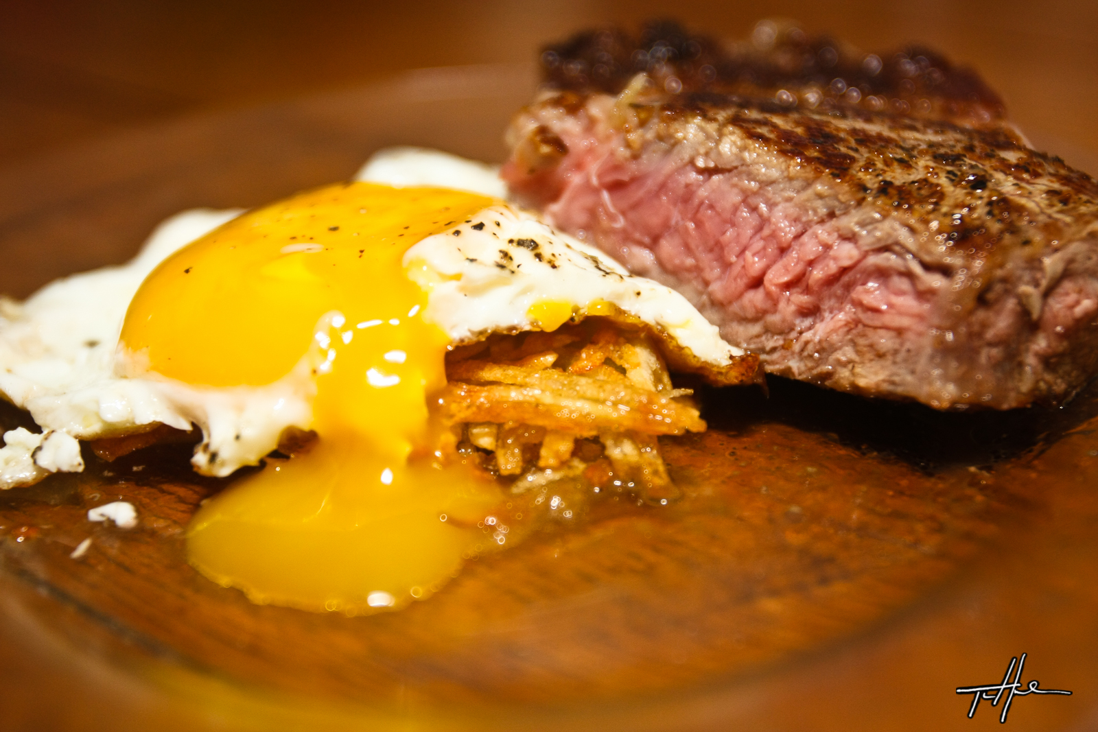 ... Steak and eggs. Rib eye steak, fresh grated hash browns and sunny side