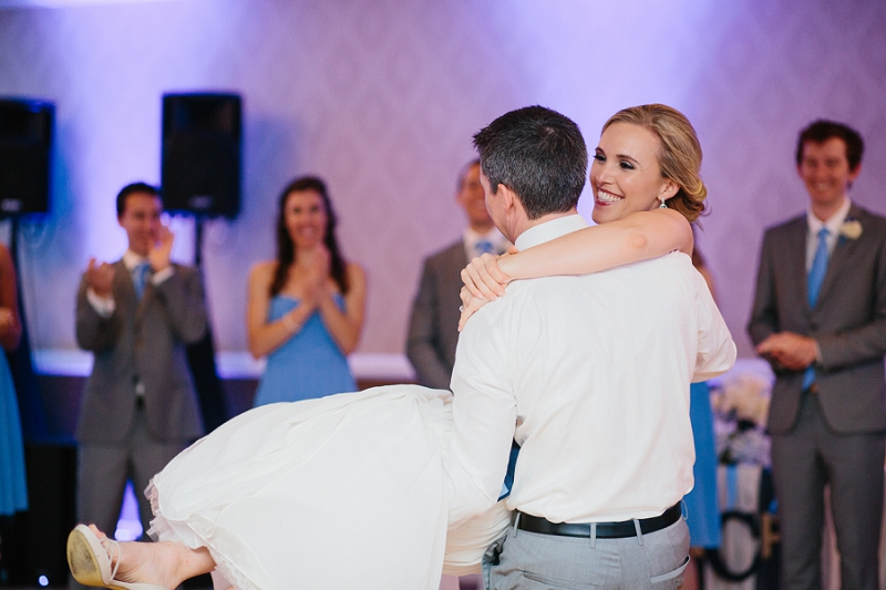 bride and groom cake dancing at wedding