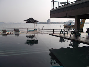 "Plush view Of Willingdon Island  from swimming pool Of ""Xandari Harbour"" boutique hotel"