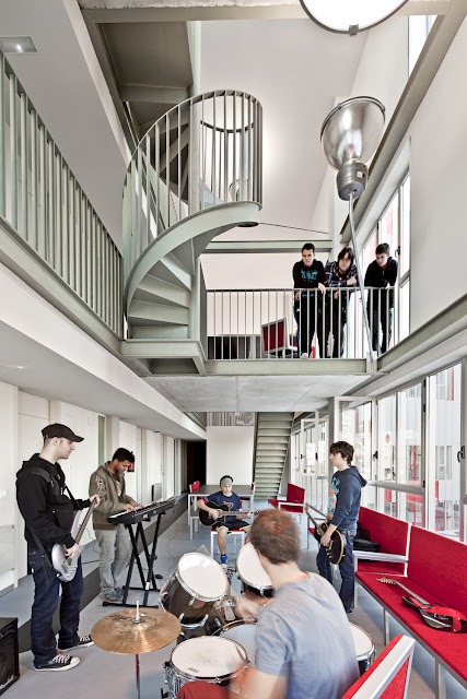 Photo of students playing with the instruments inside of the complex