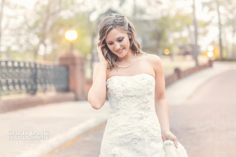 Bride walking down a brick road at River Landing.