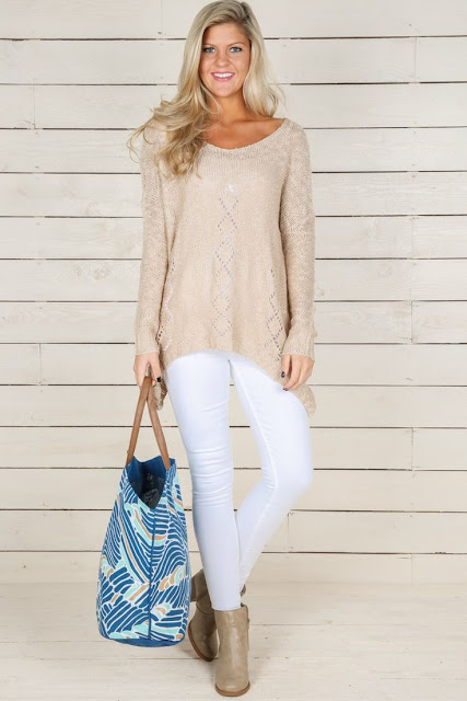 """Let the autumn harvest bring about the """"Season Of Life""""!! With this sweater you will be brought back to life in a way that you will not want to escape the season without having this make an impact! Knit sweater features a scoop neckline with diamond cutouts down the center and an asymmetrical hemline. Unlined. Semi Sheer. 55% Cotton, 35% Nylon, 10% Wool. Wash by hand in cold water or dry clean. Lay flat to dry. Do not wring, twist, or bleach. Made in China. Model is wearing a S/M."""
