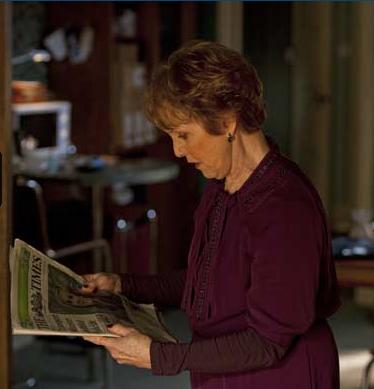 Una Stubbs as Mrs Hudson in 221 B Baker Street in BBC Sherlock