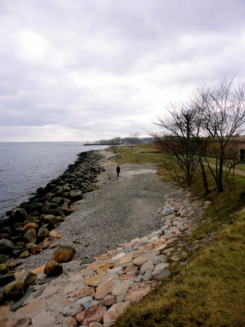 Coastal walk, with trees, beach, and ocean view beside Kronborg Castle, Helsingor, Copenhagen, Denmark