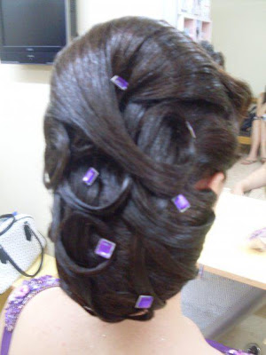 Cross twisted hair bun style for marriage reception.