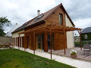 Suite du chantier de maison bois en madrier dans l'Eure et Loir près de . maison contemporaine en bois