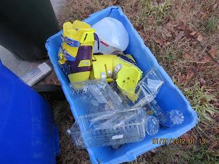 Inline skates in blue recycling bin