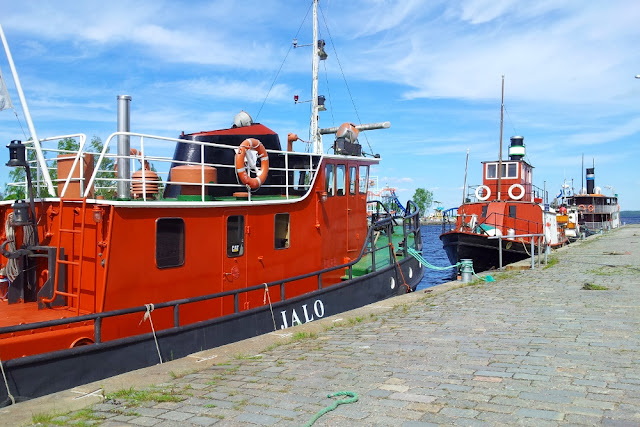 colourful schooners resting at the dock