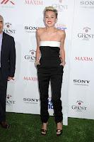 Miley Cyrus smiles for cameras