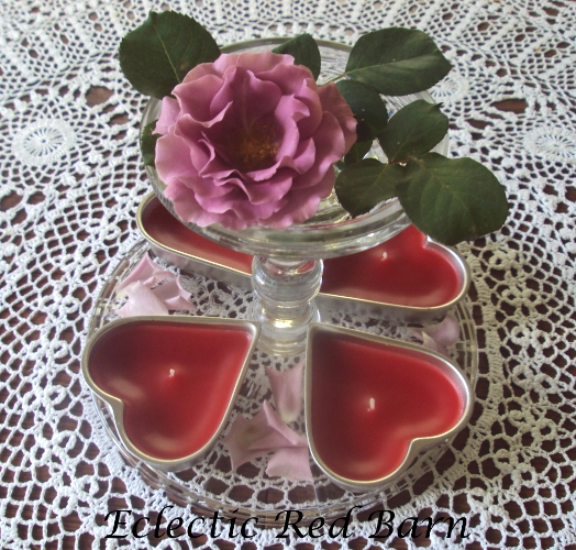 Heart-shaped Tins as Candles with a Rose