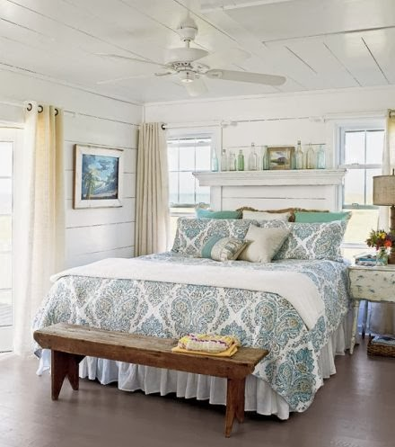 Cool Elegant mirrored accented art and side tables bine with subtle blues and breezy white in this Meg Braff Palm Beach bedroom makeover featured in House