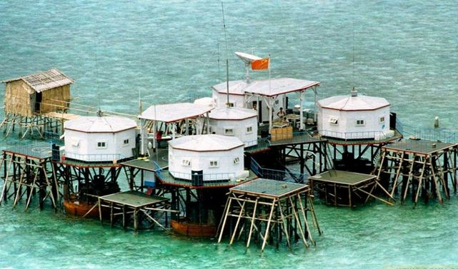 The staging of the Chinese illegal construction in Mischief Reef in the Spratly Islands after illegally seized in 1995