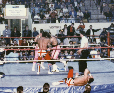 Davey Boy Smith knocks Jim Neidhart and Bret Hart's heads together in Newmarket, Ontario.