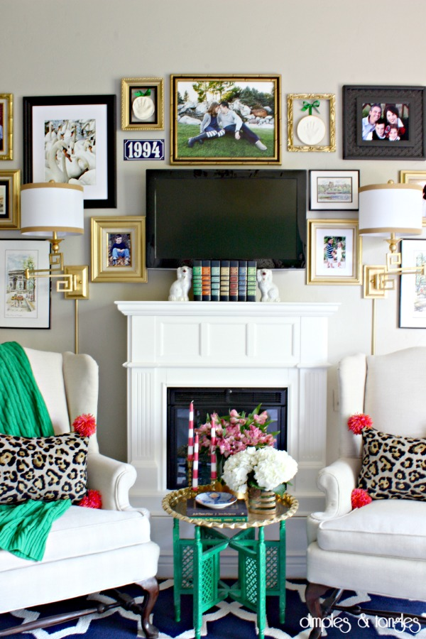 gallery wall, master bedroom, sitting area, fireplace, wingback chairs