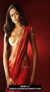 Karthika Nair in red low hip saree