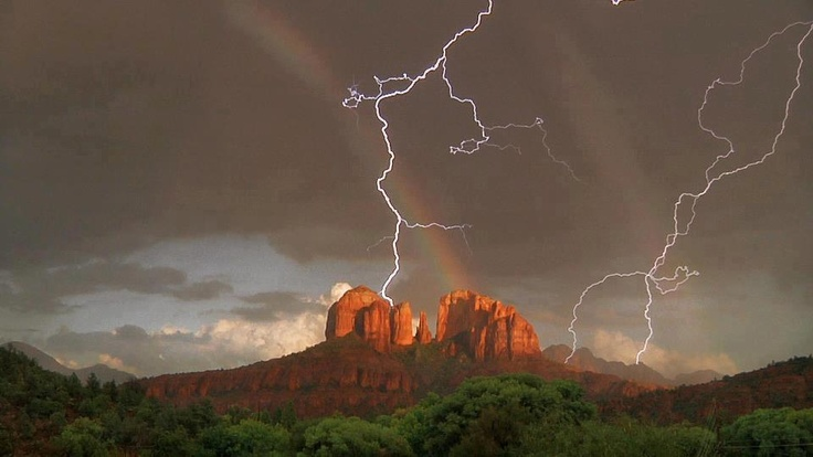 Double rainbow double lightning over Cathedral Rock in Sedona, Arizona, USA
