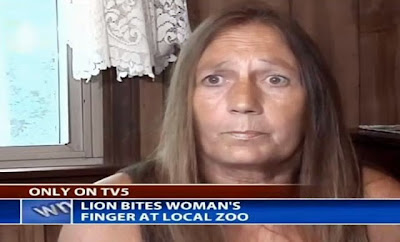 lion bites woman michigan