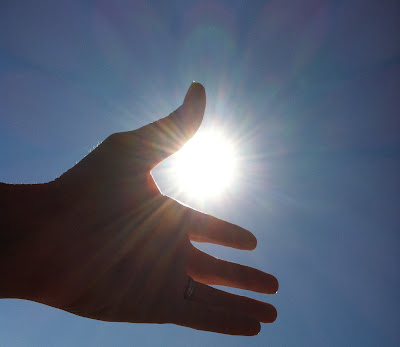 hand reaching for the sun