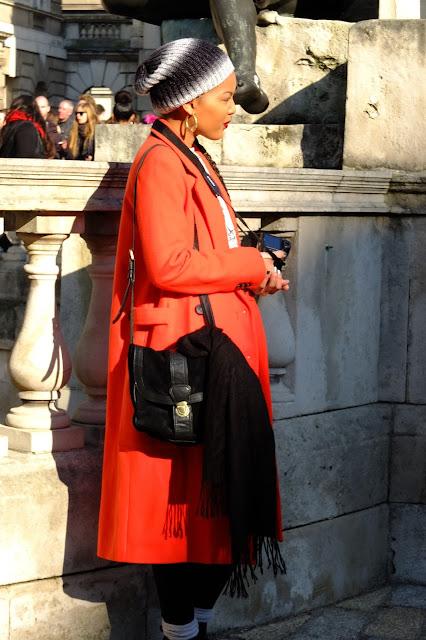 lfw beanie photographer orange coat spring trend