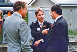 radio journalist recording an interview with two businessmen